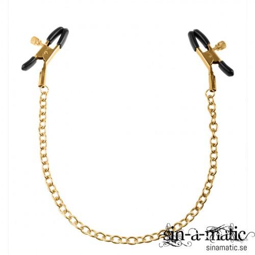 Snygga klämmor för bröstvårtorna i guld färgad metall